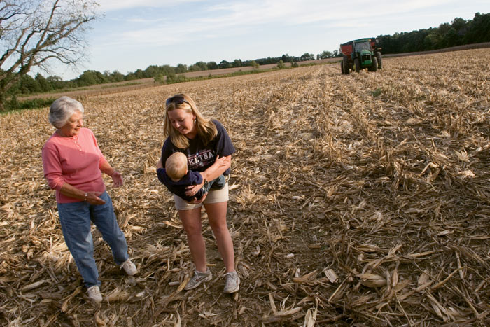 Joanna Carraway and her son, Preston, play with her grandmother Euva Carraway on their farm in Murray, Kentucky. Joanna also works at an office in town but dreams of someday returning to the farm full-time. Photo by Andy Olsen